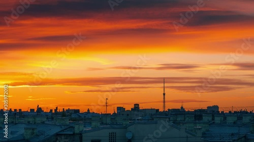 Fotobehang Epic sunset clouds in orange sky over city skyline. Saint Petersurg, Russia. Timelapse, 4K UHD.
