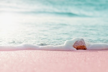 Foto auf Leinwand Rosa hell Summer pastel colored background - sandy beach and sea water over small stone
