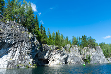 Rocks and lake of marble canyon in Ruskeala