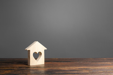 House with a heart window. Purchase of first real estate for young families and couples. Mortgage. Affordable housing. Youth support programs and incentives to increase fertility and population growth
