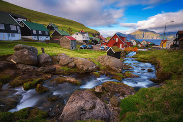 Wall Mural - Village of Gjogv on Faroe Islands with colourful houses and a creek