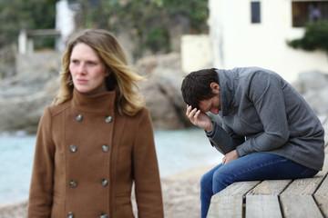 Sad husband complaining after break up in winter