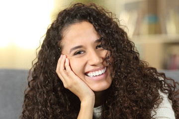 Happy woman showing perfect smile at home