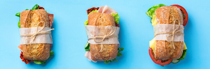 Fresh bread sandwich with ham, lettuce and tomato, banner