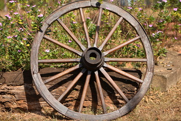 wooden wheel with iron rim and flowers