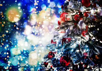 Christmas tree against a glittery luminous background
