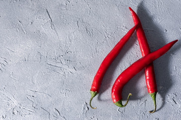 Canvas Prints Hot chili peppers red hot chili peppers on a gray stone background