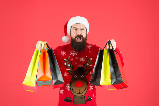 Discount. Winter shopping on budget. Upgrade your wardrobe. Man bearded hipster wear christmas sweater hold shopping bags. Sale of season. Buy new year gifts. Shopping for presents. Nice purchase
