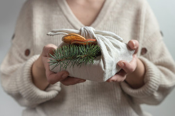 Zero waste, Christmas eco-friendly gift wrapping in traditional Japanese Furoshiki style,...