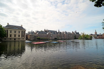 Pool with a fountain named hofvijver in front of the parliament building Binnenhof in The Hague, the Netherlands