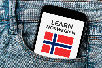 Learn Norwegian concept on smartphone screen in jeans pocket. Top view