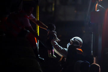 A minor arrives aboard a Spanish maritime rescue boat at the port of Arguineguin on the island of Gran Canaria