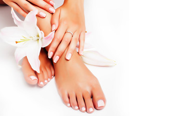 Foto op Plexiglas Pedicure manicure pedicure with flower lily closeup isolated on white perfect shape hands spa salon
