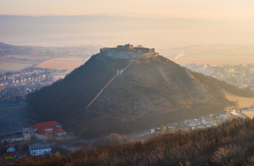 Ruin of the Castle on the Hill at Sunrise. Schlossberg Castle in Hainburg an der Donau, Austria at Sunrise as Seen from Hundsheimer Hill.
