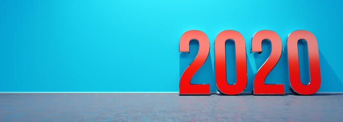 2020 new year red text supported by the blue wall