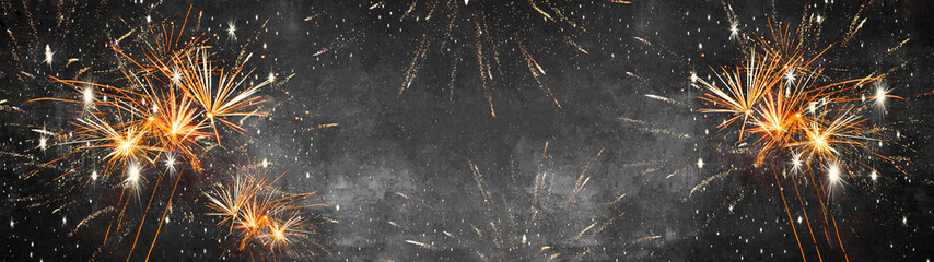 Silvester background banner panorama long- firework on rustic dark black grey stone concrete texture, top view with space for text Fotomurales