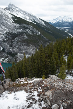 Girl infront of lake and large rocky mountain