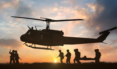 Stores photo Hélicoptère Military rescue helicopter during sunset