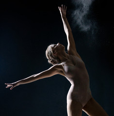 Image of artistic girl dancing with dust in studio