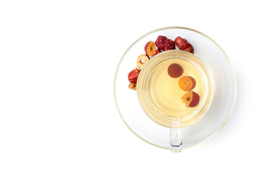 Top view (flat lay) Healthy drink brewed from Chinese jujube in a clear glass container placed on white background with clipping path.
