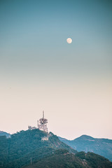 Communication Tower on the peak of mountain, evening