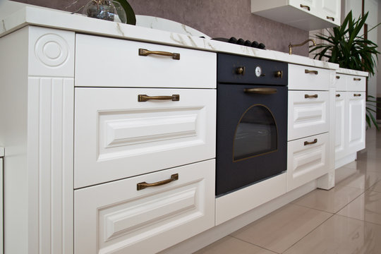 Interior of modern kitchen and white cabinets