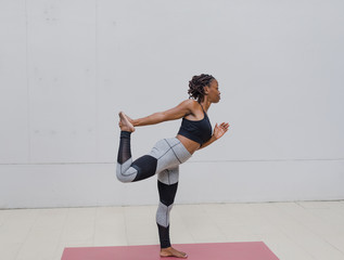 African American woman doing yoga outdoor