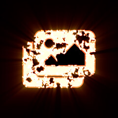 Symbol pictures burned on a black background. Bright shine