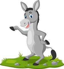 Cute donkey cartoon waving hand on the grass