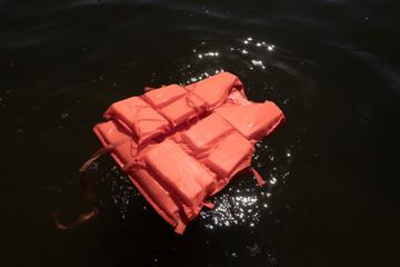 Orange life jacket in sea water.