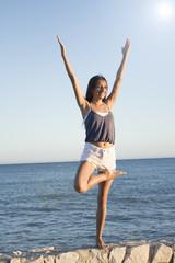 Young athlete girl doing yoga asanas
