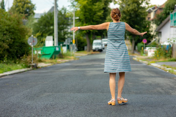 Woman with rotating poses on the road
