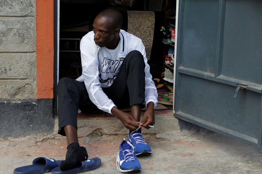 Timothy Cheruiyot, winner of the 1500 meters gold medal at the 2019 World Athletics Championships in Doha, prepares for an evening run at the Rongai Athletics club in Kajiado county