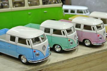 KUALA LUMPUR, MALAYSIA -DECEMBER 16, 2016: Miniature model of Volkswagen vans from Combi series on wood texture board background.
