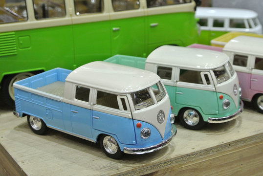KUALA LUMPUR, MALAYSIA -DECEMBER 16, 2016: Miniature model of vans from Combi series on wood texture board background.