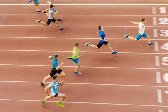 athlete runner winner of sprint race at finish motion blur