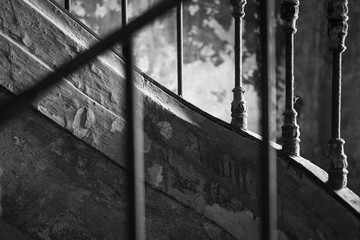 Black and white arty picture of old stairs and guardrail
