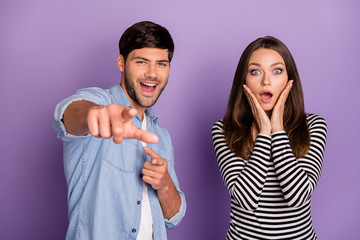 It's you. Photo of two funny people couple open mouth listen good news directing finger ahead wear stylish casual outfit clothes isolated pastel purple color background