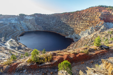 open pit mine with water Fototapete
