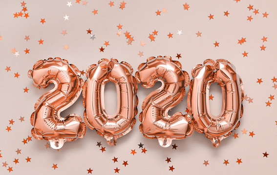 2020 balloons on pink background.