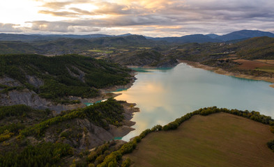 Aerial view of the Embalse de Mediano reservoir during sunset. Spain in the fall