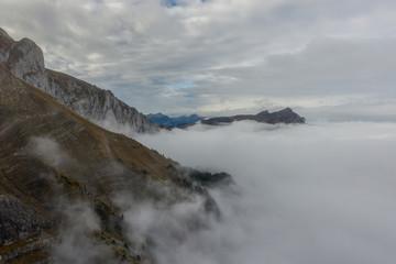 Aerial view of Mount Pilatus during sunrise and fog. Autumn Switzerland