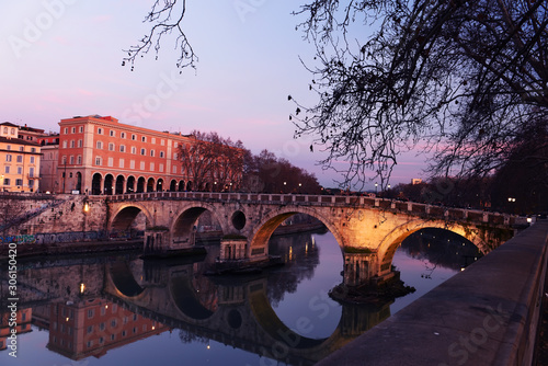 Fotomurales Evening on the embankment by the Tiber River. Rome. Italy. Urban landscape of bridges across the river.