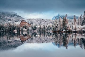 Foto auf Acrylglas Blau Jeans First snow at Strbske pleso, Slovakia. Winter nature, Christmas Scenery