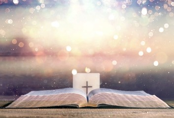 Open Holy bible book on abstract background