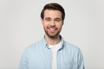 Portrait of smiling Caucasian man posing on grey background