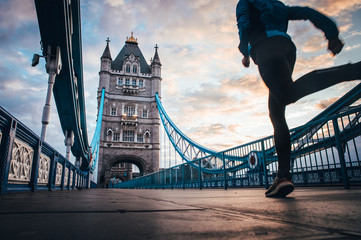 Fotobehang London running in London Concept photo. Man running on Tower bridge. London Marathon photo