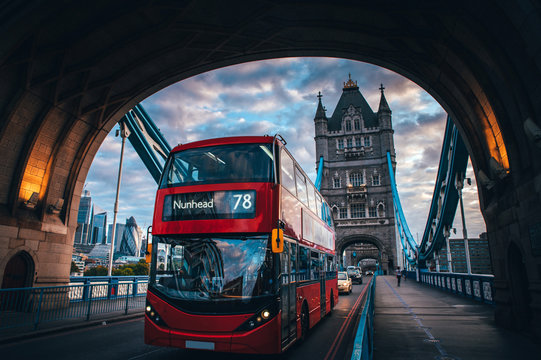 Red double decker bus at the Tower Bridge in London