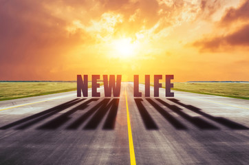 The path to a new life is the concept of changing life for the better. View words cast a shadow from the sun.