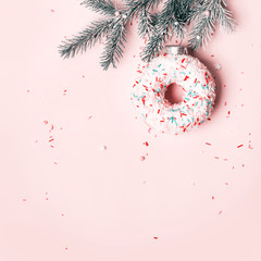 Fototapete - Christmas creative concept with ball made of donut on pink background, copy space
